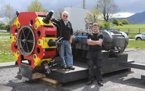 Liam & Hugh O'Connor in front of the Integrated Wood Pellet System ready to ship on a pallet